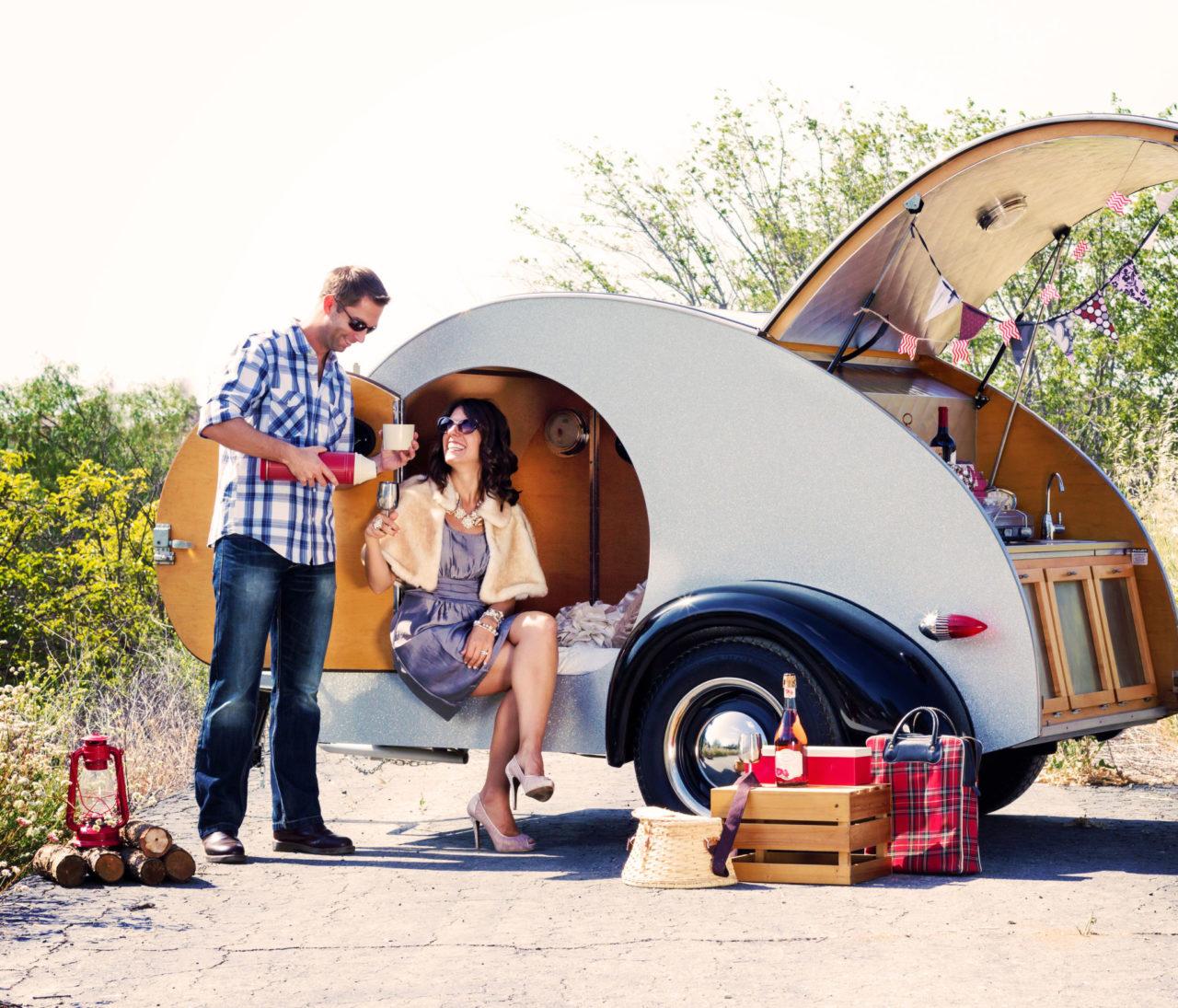 Man and woman glamorously camping